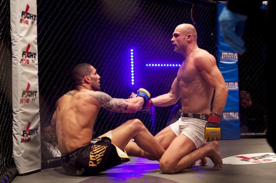 Cathal Pendred helping up fighter
